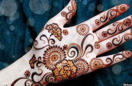 نقشهای ریز و درشت حنا روی دستان زنان در شبهای عید